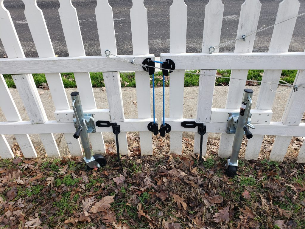 Trailer jacks added to the fence gate.