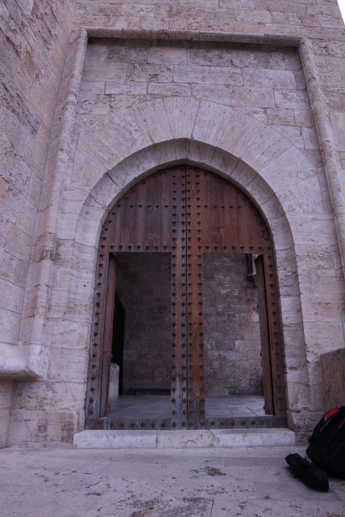 After climbing the first set of stairs you are greeted by a set of double doors. within the Torres De Quart in Valencia Spain.