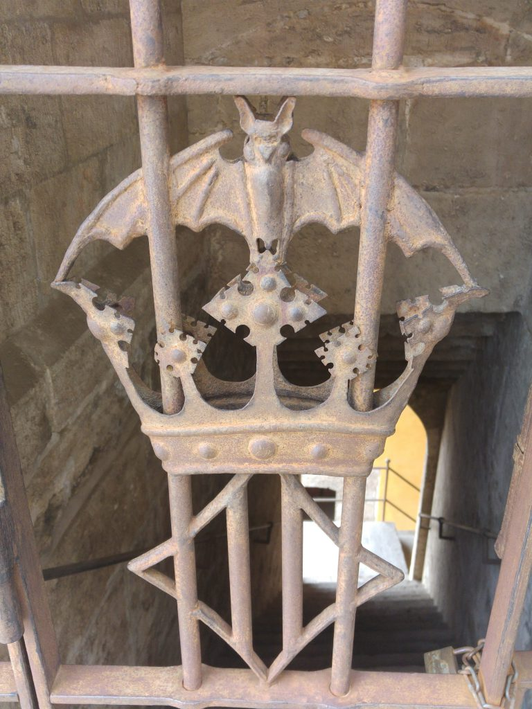 A close up of the door to the left insignia on the door within the Torres De Quart in Valencia Spain.