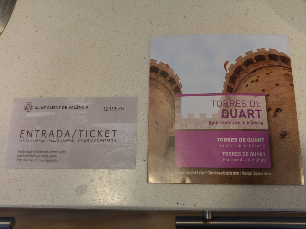 The ticket and booklet information about the Torres De Quart in Valencia, Spain.