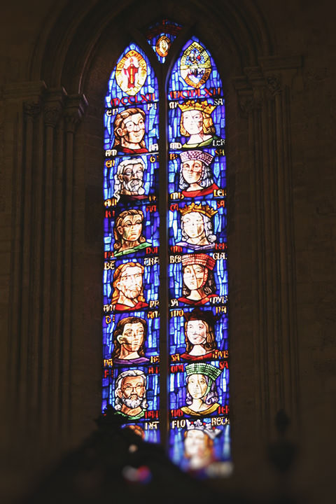 Stained glass window with couples in the Cathedral of Valencia.